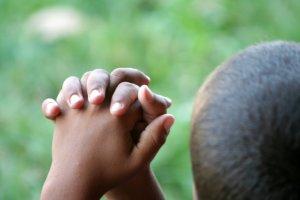 dark praying hands