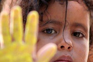 yellow hand dark child